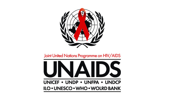 UNAIDS Country Director presents Letter of Commission to FG