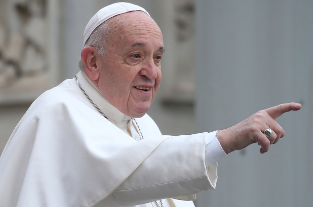 Pope urges help for poor at low-key Christmas Eve Mass