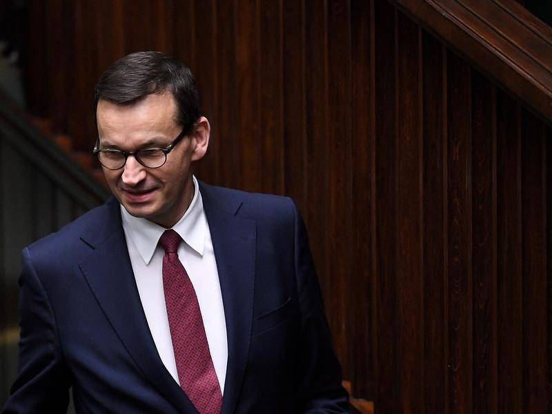 Poland apologises after PM fails to observe virus rules