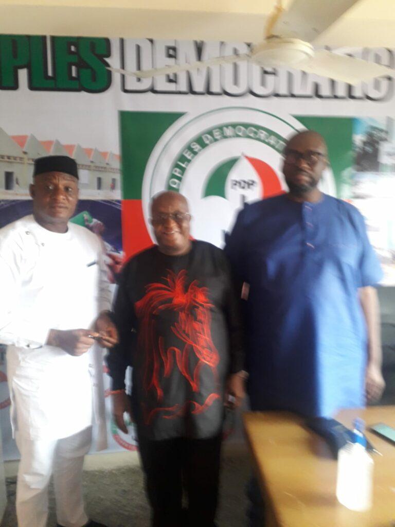 Iyoha John Darlington clad inn white with the Edo State PDP publicity secretary, Chis Nekikhare and Hon David Imafindon at the state secretariat in Benin City