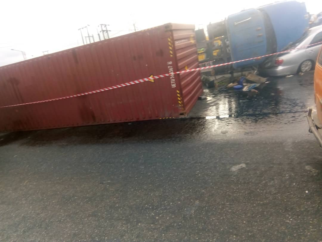 The truck and the crushed car at Cele Bus Stop, Lagos