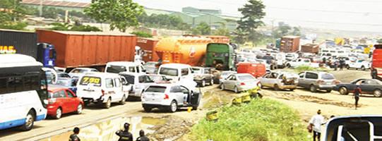 Lagos-Ibadan expressway gridlock: Passengers trek long distance to reach destinations
